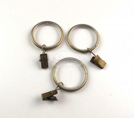 Óarany színű szilikon betétes fém függönykarika csipesszel 10 db/cs.